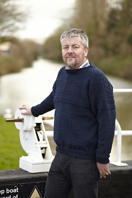 Warren wearing a blue knitted jumper