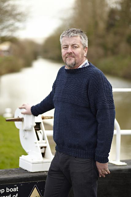 Warren wearing a blue knitted jumper